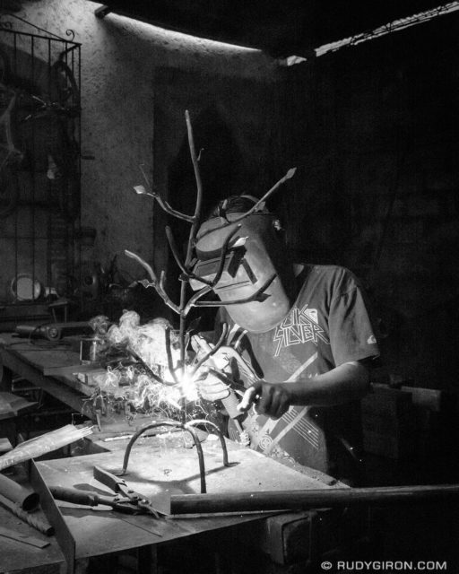 Street Photography — Metal crafts artisan at work by Rudy Giron