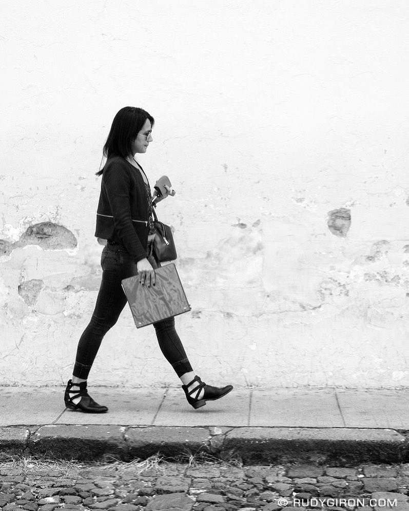 Woman on the move, Antigua Guatemala by Rudy Giron
